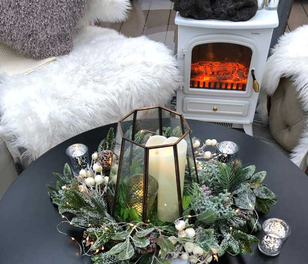 A pod interior with blow heater, furry seating throws and seasonal decorations